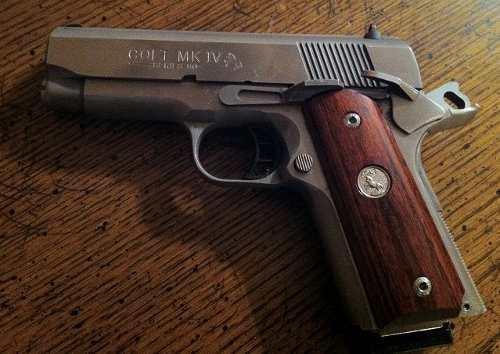 Studio shot of a Colt 1911 officer's model handgun